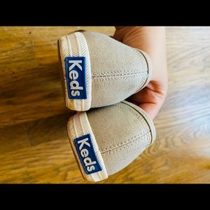 Gold Keds sneakers